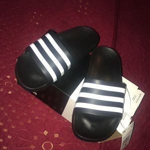 Black and white adidas sandals
